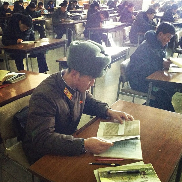North Korean soldier reading at the Grand People's Study House. Photo credits: David Guttenfelder