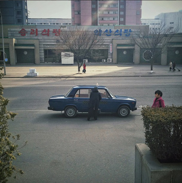 A taxi in Pyongyang streets. Photo credits: David Guttenfelder