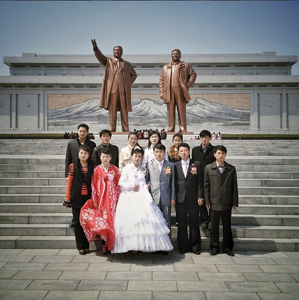 Wedding portrait in front of the two Kim's statues. Photo credits: David Guttenfelder