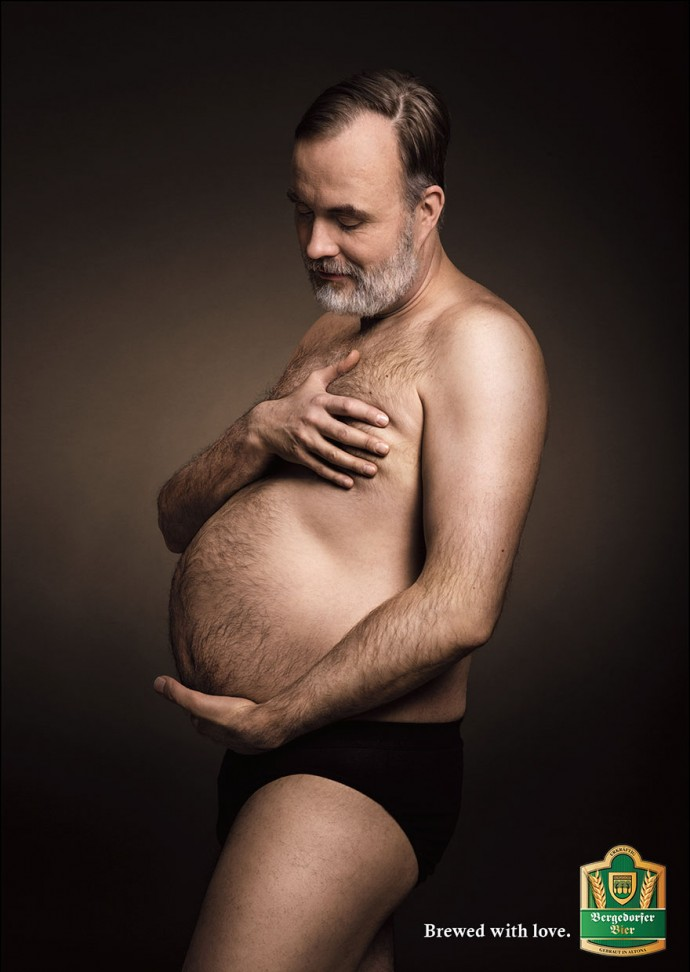 Beer Ad Shows Men Cradling Their Beer Bellies Like Pregnant Moms